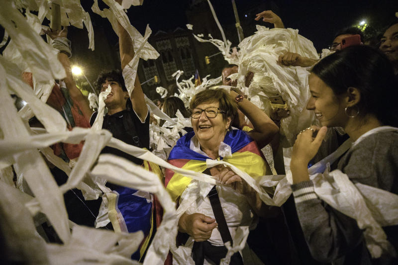 Catalan pro-independence demonstrators throw toilet paper rolls into the air during a protest in Barcelona Spain, Wednesday, Oct. 16, 2019. The Supreme Court found nine of 12 Catalan politicians and activists guilty of sedition and gave them prison sentences of nine to 13 years. Four of them were additionally convicted of misuse of public funds. The other three were fined for disobedience. (AP Photo/Bernat Armangue)