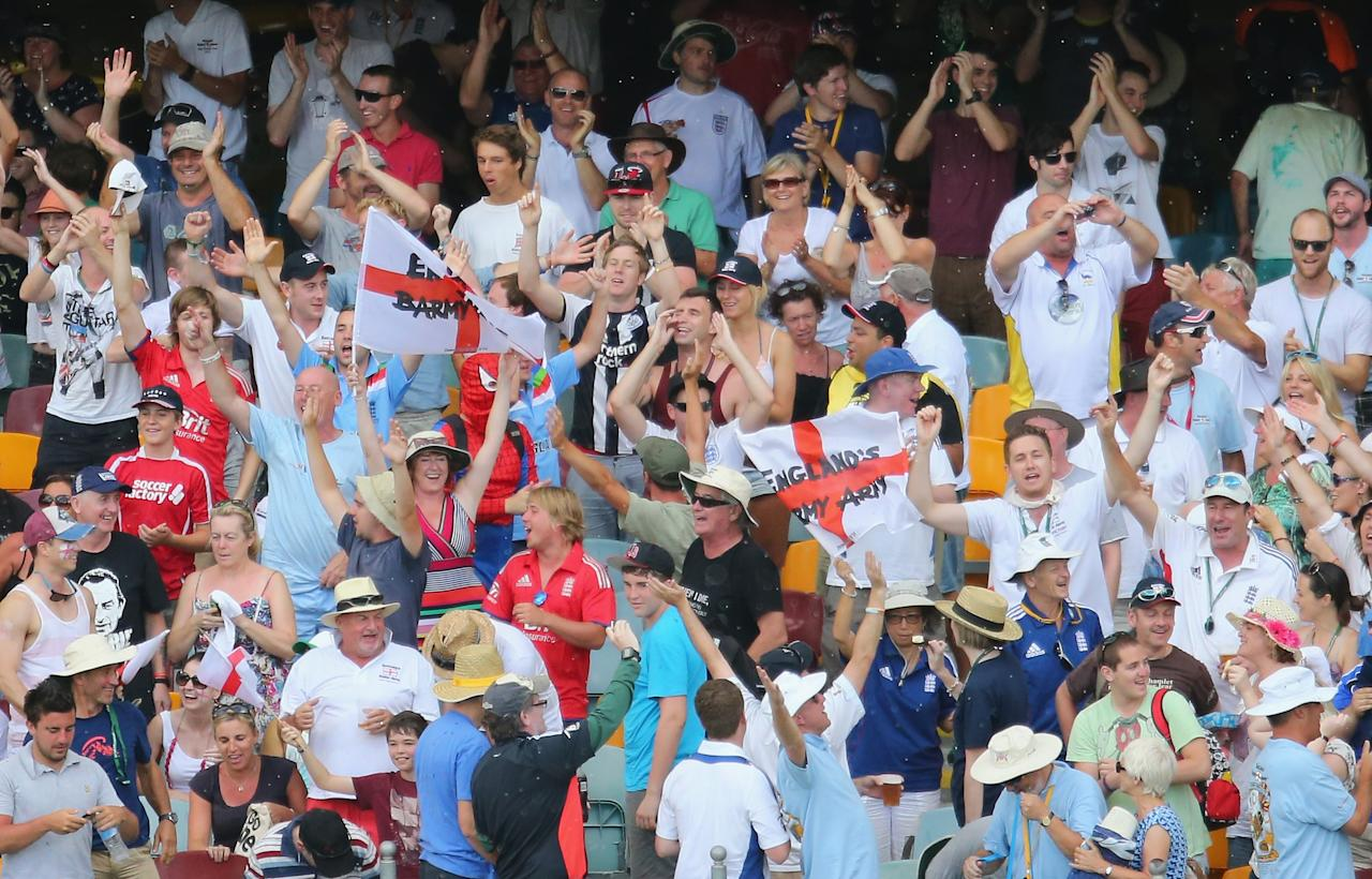 BRISBANE, AUSTRALIA - NOVEMBER 24:  The Barmy Army celebrate in the crowd as it begins to rain during day four of the First Ashes Test match between Australia and England at The Gabba on November 24, 2013 in Brisbane, Australia.  (Photo by Scott Barbour/Getty Images)