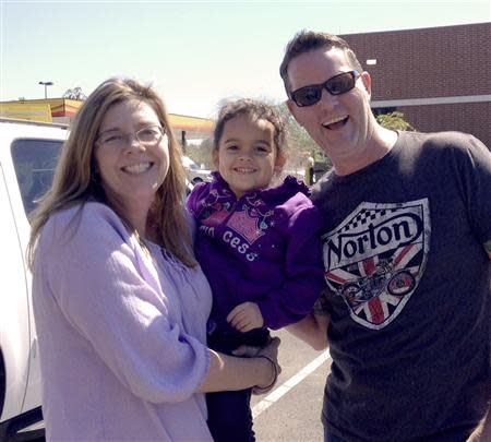 Four-year-old Veronica, is shown with her adoptive parents, Melanie and Matt Capobianco after being reunited at an undisclosed location
