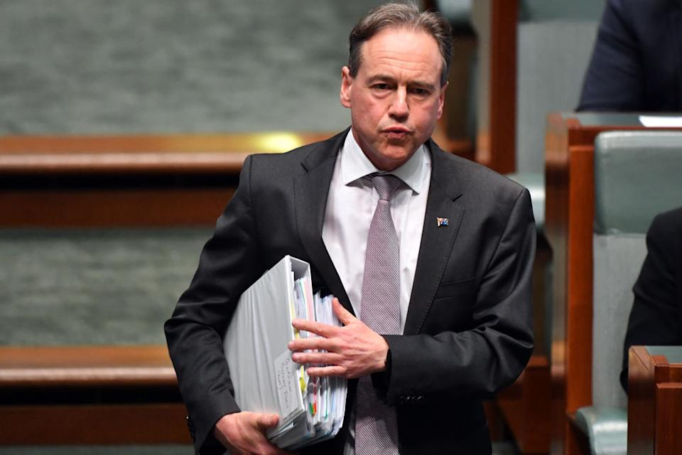 Minister for Health Greg Hunt gestures during Question Time in the House of Representatives at Parliament House in Canberra, Australia.