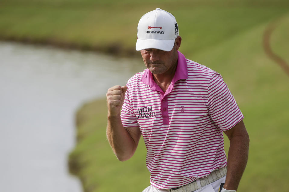 Alex Cejka, of Germany, reacts after making birdie on the 18th green on the first hole of a playoff against Steve Stricker after the final round of the Regions Tradition PGA Tour Champions golf tournament Sunday, May 9, 2021, in Hoover, Ala. (AP Photo/Butch Dill)