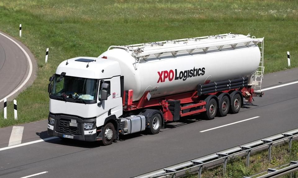 An XPO Logistics lorry with silo trailer on motorway