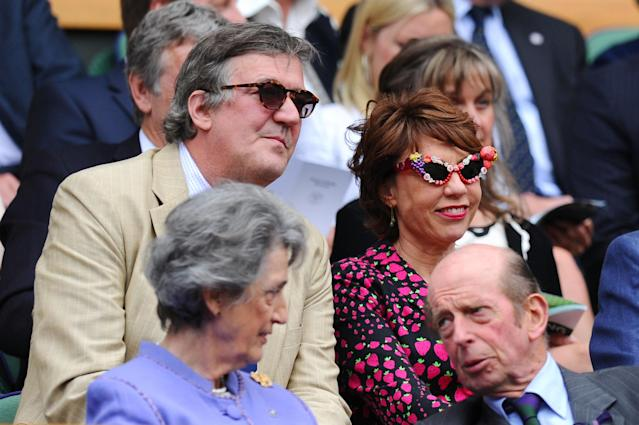 LONDON, ENGLAND - JUNE 26: Stephen Fry and Kathy Lette attend the Ladies' Singles second round match between Eugenie Bouchard of Canada and Ana Ivanovic of Serbia on day three of the Wimbledon Lawn Tennis Championships at the All England Lawn Tennis and Croquet Club on June 26, 2013 in London, England. (Photo by Mike Hewitt/Getty Images)