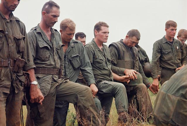 <p>Men of the 2nd Battalion, 5th Marines, in prayer, Operation Prairie, October 1966. (Photograph by Larry Burrows) </p>