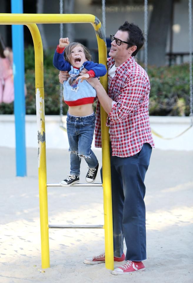 Johnny Knoxville and his son, Arlo, hung out at a Malibu, California, playground. We dig their matching Converse sneakers! (8/20/2013)