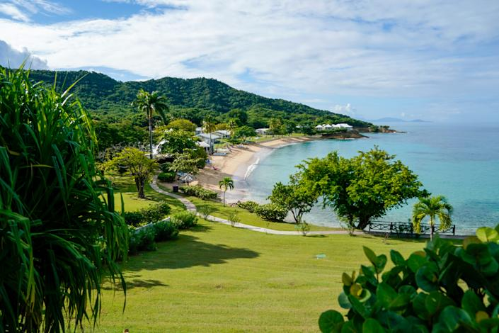 Antigua, which is 108 square miles long, is known for its majestic beaches. Here is a view from the Hawksbill, one of the oldest resorts on the island. An old sugar mill on the property has been converted into the resort's gift shop.