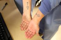 FILE PHOTO: Coronavirus disease (COVID-19) ICU nurses display tattoos they all got to commemorate their bond as frontline workers and the people they have lost, at Providence Mission Hospital in Mission Viejo