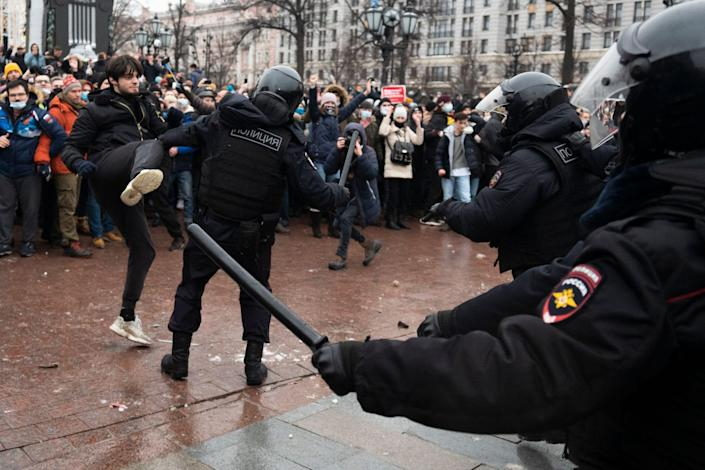 A demonstrator clashes with a police officer during a protest in Moscow's Pushkin Square against the jailing of opposition leader Alexei Navalny in this Jan. 23, 2021 photo.