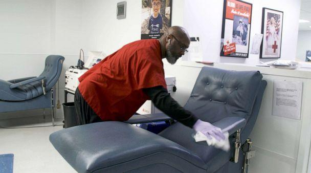 PHOTO: A worker cleans a chair between donors at the Dr. Charles R. Drew Blood Donation Center in Washington, D.C., in an image made from undated handout video. (Brad Zerivitz/American Red Cross)