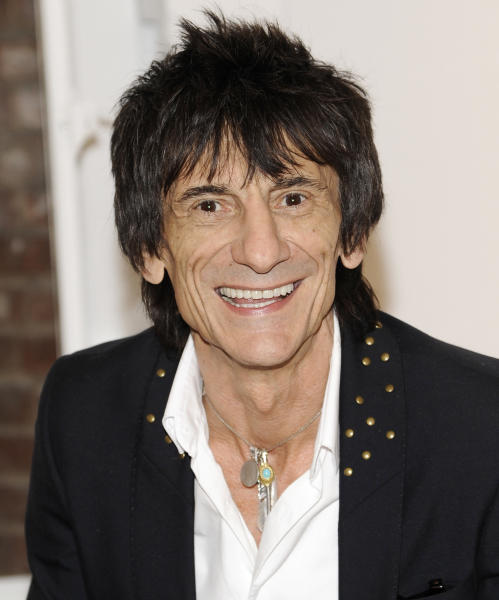 """Rolling Stones guitarist Ronnie Wood appears during a news conference unveiling his new art exhibit """"Faces, Time and Places"""" on Monday, April 9, 2012, in New York. (AP Photo/Evan Agostini)"""
