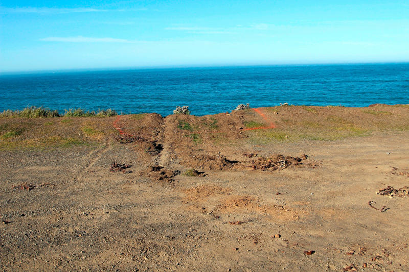 FILE - This March 29, 2018, file photo, shows ruts cut into the clifftop where the SUV of Jennifer and Sarah Hart that went off the cliff was hauled up and over by a tow truck off the Pacific Coast Highway near Westport, Calif. A body was recovered Saturday, April 7, 2018, in the vicinity where the SUV plunged off a Northern California cliff last month, killing the family of eight in what authorities suspect may have been an intentional crash. (Kale Williams/The Oregonian via AP, File)