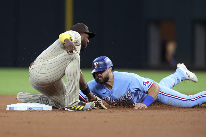 Texas Rangers' Joey Gallo steals second as San Diego Padres second baseman Jurickson Profar tries to tag him in the first inning during a baseball game on Sunday, April 11, 2021, in Arlington, Texas. (AP Photo/Richard W. Rodriguez)
