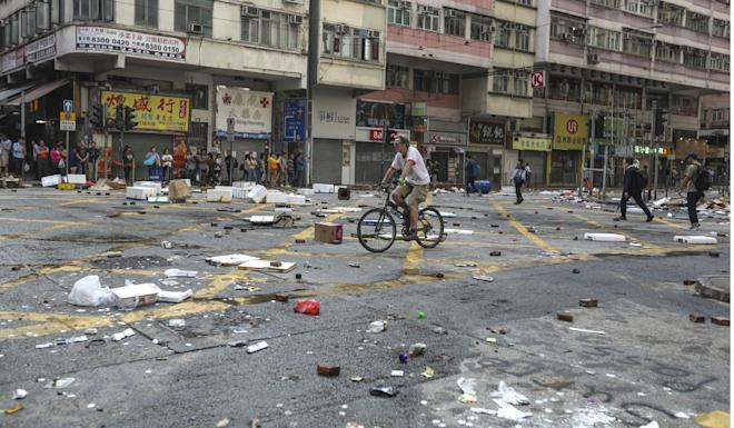 Debris covers the street in Sai Wan Ho after the shooting incident. Photo: Nora Tam