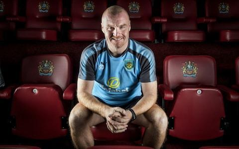 "Sean Dyche is explaining the nature of ""positive realities"", the phrase he uses for being honest with his players about the challenge they face at the Etihad Stadium on Saturday against a Manchester City team that are not just top of the Premier League but playing like they very much intend to stay there. The Burnley manager has not built the career he has now from being unrealistic about his teams' capabilities and in his third season as a Premier League manager, it is impossible to ignore how far he has come. After Craig Shakespeare's sacking at Leicester City this week we are down to four permanent English top-flight managers, and top of them all is Dyche with a side that has lost just once in the league this season and begin the day in seventh place. Pep Guardiola's team currently look like they could dismantle most sides in Europe and yet, as the City manager will know from the narrow margins of victory over Burnley last season, Dyche is quite capable of finding ways to compete. The 46-year-old shakes his head at the suggestion that this game represents a free hit for his club. ""Don't think we just do five-a-sides all week and say 'Oh well, roll out and hope for the best'. We want to do our job, and deliver a performance. That's important."" As that rare thing, an English manager in the Premier League, Dyche's career has been one in which he has had to survive first and learn fast, through two promotions and one relegation with Burnley. Ten years ago last summer a casual chat with Aidy Boothroyd on a bench at the Watford training ground persuaded the latter to appoint Dyche as the Under-18s coach. Ironic, really, Dyche reflects - Boothroyd had not wanted him as a player but was big enough to see his qualities as a coach. So began the journey that led to Burnley, where he will pass his fifth anniversary as manager next week, after the meeting with Guardiola. Last year they bumped into each other after the game at Turf Moor, a 2-1 win for the away side, and Guardiola told Dyche how his team had been unable to ""dominate"" Burnley. The City manager acknowledged he had faced a team who were well-drilled and knew their jobs to the last detail. Dyche is not a man who requires a pat on the head but this compliment, from one coach to the next, resonated with him. Dyche still talks to his old Chesterfield manager John Duncan, a man it took him a year to grasp Credit: PAUL COOPER for the Telegraph ""We don't do blind faith, we do authentic optimism,"" he says. ""There's no point saying, 'City are not all that', because they are. We don't do nonsense. We tell the players the truth. 'This is a very good side with good individuals, a good structure, they are tighter than they were out of possession and more open in possession. Now what are we going to do?' ""Positive realities. What are the things we can do to take on the challenge? There's no 'Come on lads! Let's do it! And if we think positively we will win!' It just doesn't work like that. There has to be more to it. The teams that you come across, they are not physically super-human, they are just very good. So it is asking what do we about that. How do we take on the challenge?"" The solutions that Dyche has found to the issue of keeping Burnley competitive in the top-flight have looked increasingly attractive to others. He has been installed as the bookies' favourite for the King Power job and the prejudices some might have held about a former lower league defender with a cement-mixer voice are gradually evaporating with Burnley's relative success on a shoestring budget. Dyche, who first took Burnley up in 2014, has spent five productive years at Turf Moor Credit: Action Images / Paul Currie Dyche is aware of what he calls the ""myths"" around him, and he mentions them often. That he keeps the same players – ""only six of the 22 from when I started are still here, so something's changed!"" That he does not like signing foreign players – ""A good player is a good player, it's just that we cannot afford signings that do not work"". That he is a 4-4-2 man – ""we adjust and flex it"". And you can see quickly why players do stay: Dyche considers their development the most rewarding part of his job. He comes from Kettering, where his father Alan was a consultant in the steel industry and his mother Patsy stitched the bench-made shoes for which Northamptonshire is famous. Guardiola may have the hoodies, and the skinny jeans, but no manager knows real shoes like Dyche. He reels off the names, Cheaney, Church's, John Lobb, Jeffery West. His mother stitched the early Dunlop boots worn by Trevor Brooking and Dyche is also a 1980s football boot connoisseur, a man who knows his Adidas Profi from his Stratos SL but is adamant that nothing beats a pair of World Cups. He recalls calling home from a tour in France with Nottingham Forest's youth team when he complained to his father that a favourite of the coach was being picked ahead of him. ""My dad was like 'Stop that. You work hard, son, that's how you move forward. Don't make excuses. Get your head down and work hard'. Brilliant advice. Not getting in the way, not going to see the coach. But times have changed and you have to change with them."" Dyche, a Northants native, is a connoisseur of classic boots Credit: PAUL COOPER FOR THE TELEGRAPH Dyche will admit that his roots are in a lost world of English football, around the fringes of Brian Clough's last Forest team but never part of it, and then a hard-won career in the lower-leagues with the likes of Chesterfield, Millwall and Northampton. But you do not get to seventh in the Premier League in this brutal era of hire-and-fire without his keen intelligence and a natural curiosity about the game. Dyche has a thousand ideas and as many stories, and he recalls a tough time at Bristol City when he played under the Swedish coach Benny Lennartsson. ""All the players were like, 'He's rubbish'. I thought: 'You lot have lost your mind. He's ahead of the curve.' It was everywhere: tactically, his understanding of details, changing training, the professionalism - a massive shift. You could just smell it on him. He was a talker not a shouter and it was when football was just turning."" No manager who keeps a club with finances as modest as they are at Burnley buoyant in the Premier League will be expected to stay forever, so the question is how Dyche sees his career. Without Boothroyd's faith, and then Malky Mackay's insistence that Dyche be appointed his assistant at Watford in 2009, when the club wanted an older man, he admits he could have stayed much longer in youth development. The next fork in the road could be even more significant. ""You need doors to open, you need a chance – and you have got to have something, to take your chance when the door opens at the right time. My first port of call was to be a manager, then it was a successful manager, then it was a Premier League manager. Then, can I stay in the Premier League? What opens next? I am at A and going all the way to Z is high unlikely in any career, let alone football. You have to weave your way like the river, pick up your skills and keep going. ""Some jobs you look at and think: 'That's nearly impossible to turn round.' But what are your circumstances? If you are in a job and another becomes available and you can't see a way of that moving forward, then you have a choice. If you are out of work and a job becomes available you might think: 'I have to take it because jobs are so scarce.'"" He still speaks to his old Chesterfield manager John Duncan who plotted that miracle run to the 1997 FA Cup semi-final in which Dyche scored a penalty against Middlesbrough. He says that for the first year the pair did not get on - Dyche simply could not see what his manager was trying to do. When at last it became clear he ""marvelled"" – his word – at how Duncan had spotted the team's hitherto hidden potential. Another useful lesson picked up along the way and one more reason to approach Saturday without fear."