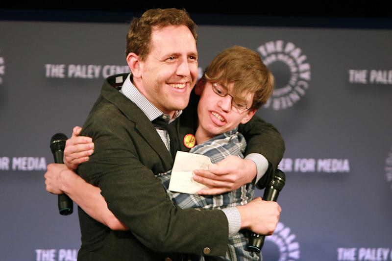 """Filmmaker Lee Hirsch left, embraces film subject Alex Libby at a special screening of """"Bully"""" presented by The Weinstein Company and JP Morgan Chase and Company in partnership with Bing and Gucci, in New York on Tuesday, March 20, 2012. The film, directed by Hirsch, will be released in theaters on March 30. (AP Photo/StarPix, Dave Allocca)"""