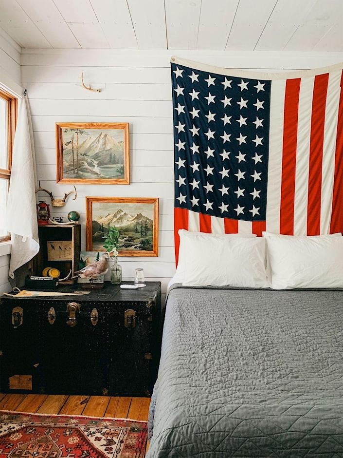 """<p>It may not be <a href=""""https://www.goodhousekeeping.com/home/craft-ideas/g2477/american-crafts/"""" rel=""""nofollow noopener"""" target=""""_blank"""" data-ylk=""""slk:July 4th"""" class=""""link rapid-noclick-resp"""">July 4th</a>, but that's no reason not to put your patriotic spirit on full display. In lieu of a traditional headboard, fill the space with the American flag.</p>"""