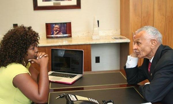 LaTosha Brown, a Georgia voting rights activist, speaks with the Rev. C.T. Vivian, a pioneering force in the Civil Rights Movement and integral to the passage of the Voting Rights Act in 1965. Vivian's colleague in that fight was Georgia congressman John Lewis; Vivian and Lewis recently passed away within hours of each other.