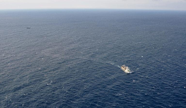 This handout picture taken and released by Russia's Emergency Ministry on April 2, 2015 shows ships carrying out a search operation in the Sea of Okhotsk where the trawler Dalny Vostok sank