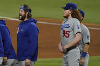Los Angeles Dodgers starting pitcher Clayton Kershaw celebrates their win against the Tampa Bay Rays in Game 5 of the baseball World Series Sunday, Oct. 25, 2020, in Arlington, Texas. Dodgers beat the Rays 4-2 to lead the series 3-2 games. (AP Photo/Tony Gutierrez)
