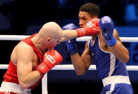 FILE PHOTO: Tony Yoka of France (R) fights Ivan Dychko of Kazakhstan during their Men's Super Heavy final at the AIBA World Boxing Championship in Doha October 15, 2015. REUTERS/Naseem Zeitoon Picture Supplied by Action Images/File Photo