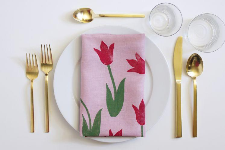 "<p>These tulip napkins make a gorgeous addition to Mom's spring table dressing, and they're homemade! An older helper will need to make the stamps, but toddlers will have fun dipping them in paint and creating the napkin design.</p><p><em><a href=""http://thehousethatlarsbuilt.com/2016/04/diy-block-print-tulip-napkin.html/#more-20668"" rel=""nofollow noopener"" target=""_blank"" data-ylk=""slk:Get the tutorial."" class=""link rapid-noclick-resp"">Get the tutorial.</a></em></p>"