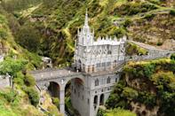 "<p>Spanning across a forested gorge on the border of Colombia and Ecuador, <a href=""http://santuariolavirgendelaslajas.com/index.html"" rel=""nofollow noopener"" target=""_blank"" data-ylk=""slk:La Lajas Sanctuary"" class=""link rapid-noclick-resp"">La Lajas Sanctuary</a> boasts an origin story as miraculous as its location. The tale says that Amerindian Maria Meneses de Quiñones and her deaf-mute daughter Rosa found themselves caught in a brutal storm near the gorge in 1754. Hiding under the rocks, the women saw an illuminated figure thought to be the Virgin Mary above the rocks. Instantaneously, Rosa was able both hear and speak, and their story spread throughout the region. After reports of similar miracles happening to those who visited Las Lajas, it was decided in 1916 a neo-Gothic church would be built among the green cliffs and cascading waterfall.</p>"