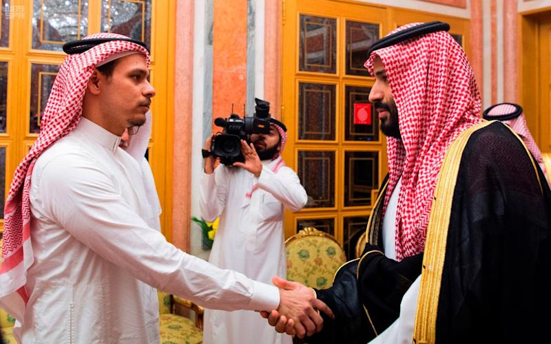 Saudi Crown Prince Mohammed bin Salman (right) shakes hands with Salah Khashoggi, son of Jamal Khashoggi, in Riyadh on Oct. 23, 2018. (Photo: Saudi Press Agency via ASSOCIATED PRESS)