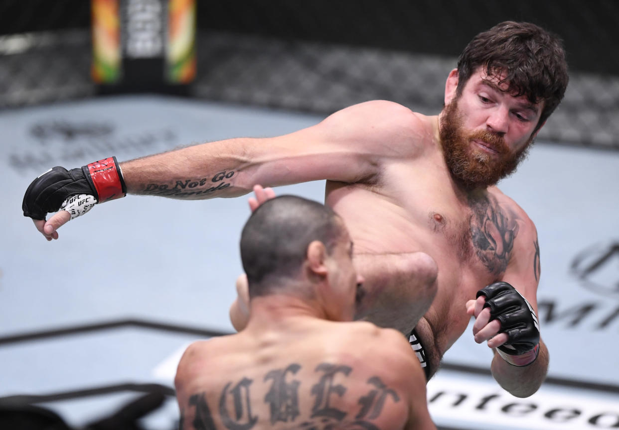 LAS VEGAS, NEVADA - AUGUST 15: (R-L) Jim Miller kicks Vinc Pichel in their lightweight bout during the UFC 252 event at UFC APEX on August 15, 2020 in Las Vegas, Nevada. (Photo by Chris Unger/Zuffa LLC)