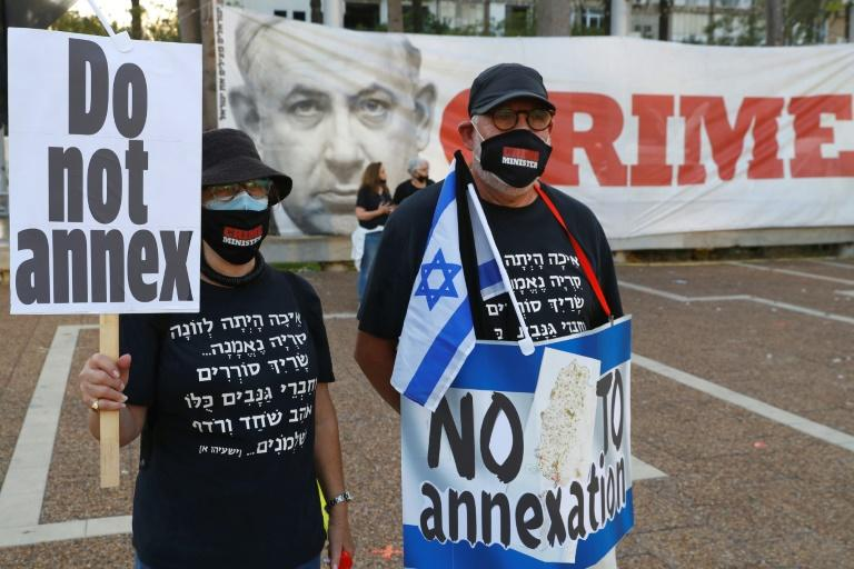 Protesters gather in Tel Aviv's Rabin Square on June 6 to denounce Israel's plan to annex parts of the occupied West Bank (AFP Photo/JACK GUEZ)