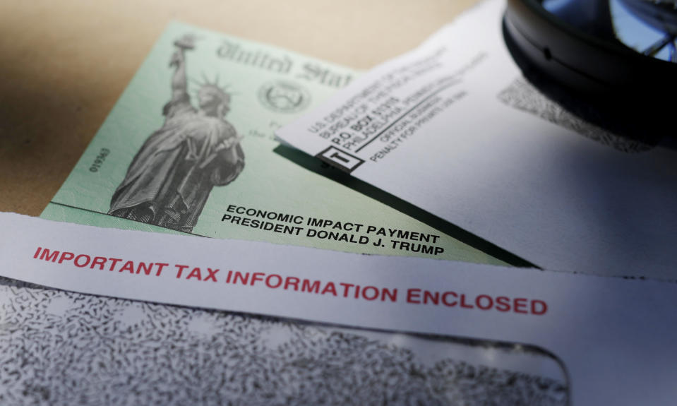 FILE - In this April 23, 2020, file photo, President Donald Trump's name is seen on a stimulus check issued by the IRS to help combat the adverse economic effects of the COVID-19 outbreak, in San Antonio. There were just a few hundred coronavirus cases when Congress first started focusing on emergency spending in early March. By the end of that month, as Congress passed the massive $2.2 trillion Cares Act, cases skyrocketed above 100,000 and deaths climbed past 2,000. (AP Photo/Eric Gay, File)