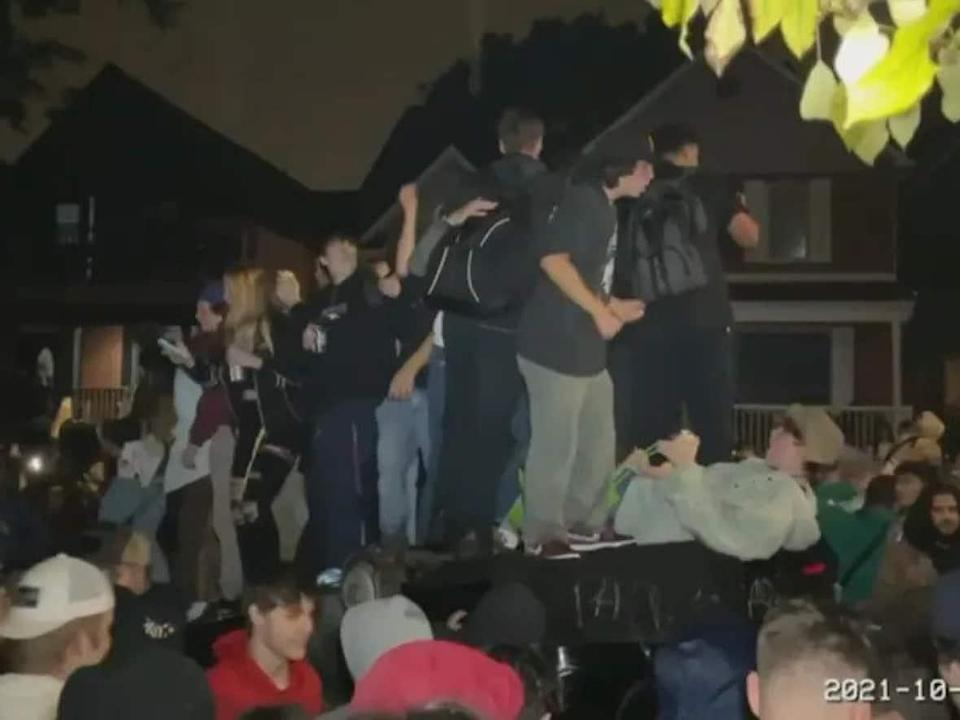 A scene from the raucous Panda Game party that took over Ottawa's Sandy Hill neighbourhood on the weekend. Police announced Thursday that they had charged three men, all in their 20s. (Radio-Canada - image credit)