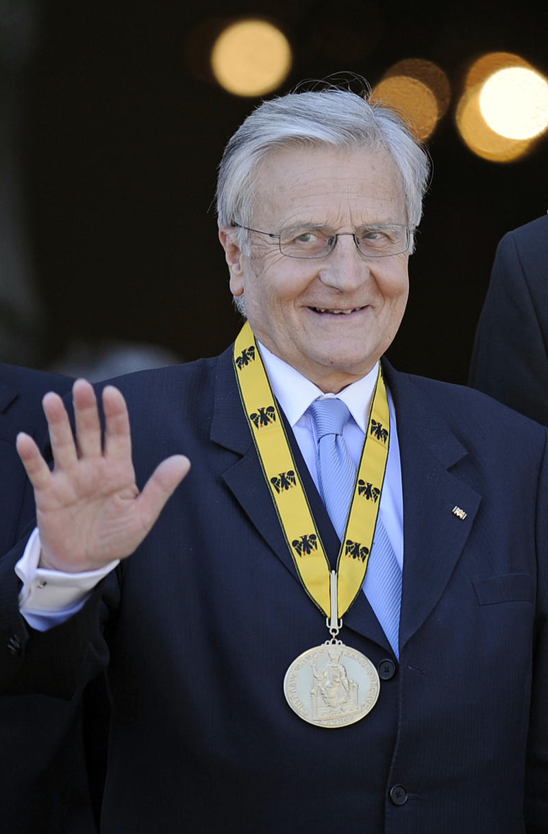 President of the European Central Bank Jean-Claude Trichet waves from the balcony after he received the International Charlemagne Prize of Aachen (Karlspreis) in the city of Aachen, western Germany, Thursday, June 2, 2011. Trichet has won this year's prestigious Charlemagne Prize for his efforts to keep the euro stable amid the economic crisis, the prize committee said. The important political prize is awarded to outstanding Europeans since 1950. (AP Photo/Martin Meissner)