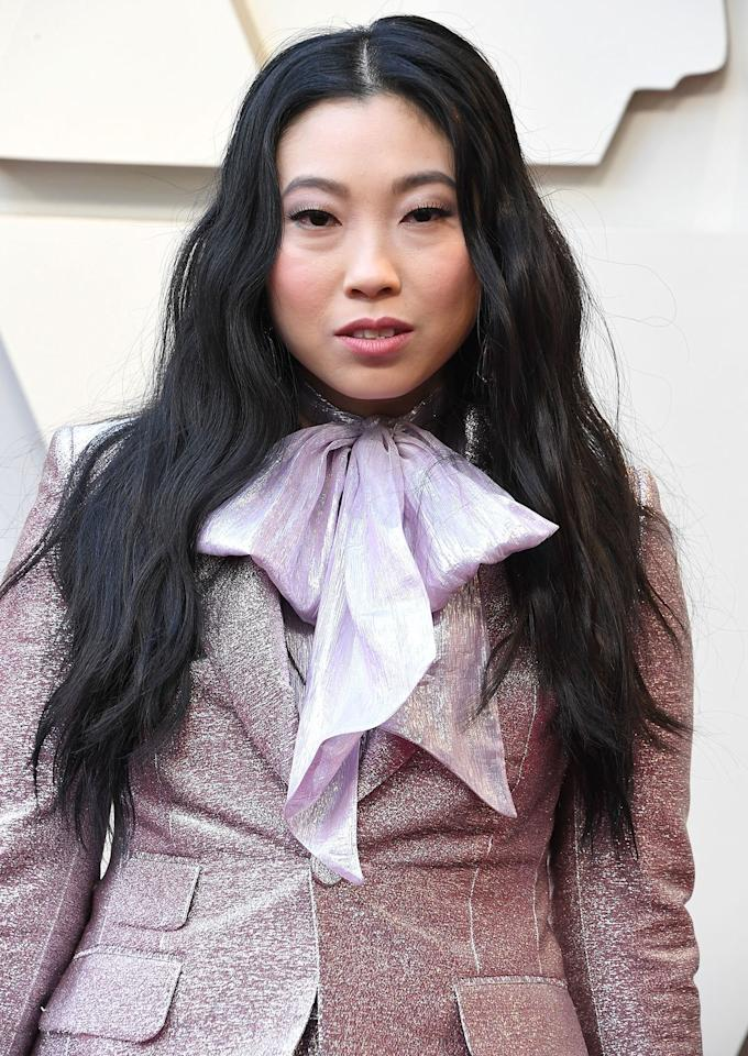 """<p>Soft, loose waves remain popular because it's a look that's amazing for any occasion. Hairstylist Anh Co Tran used <a href=""""https://click.linksynergy.com/deeplink?id=93xLBvPhAeE&mid=1237&murl=https%3A%2F%2Fshop.nordstrom.com%2Fs%2Fghd-platinum-1-inch-styler%2F5113921&u1=IS%2CHolidayHair%2Clukase%2C%2CIMA%2C3490676%2C201910%2CI"""" target=""""_blank"""">ghd's Platinum+ Styler</a>, a flat iron with rounded edges, to give Awkwafina's hair a lived-in texture. Gently brushing the waves out after, keeps the style from looking too """"done."""" </p>"""