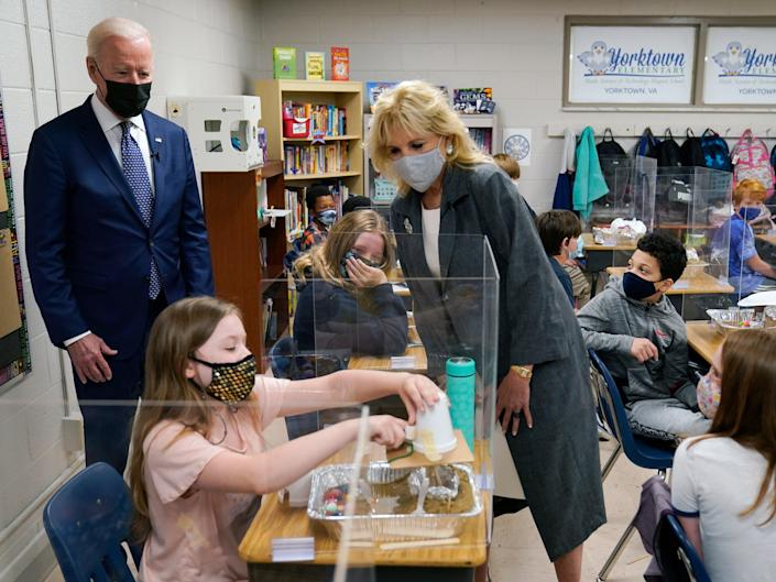 President Joe Biden and first lady Jill Biden watch a student demonstrate her project during a visit to Yorktown Elementary School, on Monday, May 3, 2021, in Yorktown, Virginia.AP