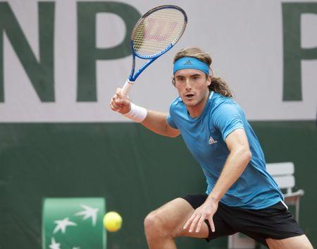 May 26, 2019; Paris, France; Stefanos Tsitsipas (GRE) hits the ball during his match against Maximilian Marterer (not pictured) on day one of the 2019 French Open at Stade Roland Garros. Mandatory Credit: Susan Mullane-USA TODAY Sports
