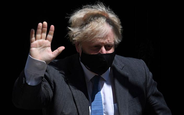 Boris Johnson: Cabinet colleagues appear more in a rush to get rid of their masks - AFP