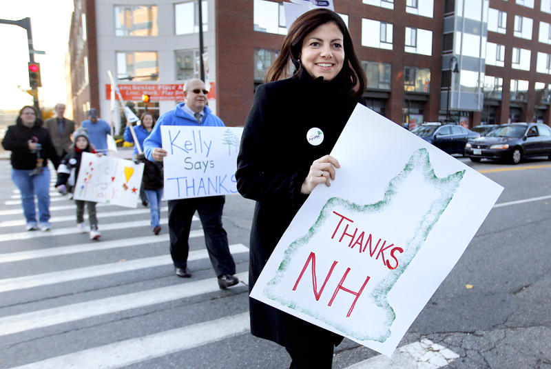 FILE - In this Wednesday, Nov. 3, 2010 picture, Republican Sen.-elect Kelly Ayotte and some supporters hold signs in Manchester, N.H. to thank voters. Even though many high-profile women ran for office, feminists say the 2010 campaign was rife with sexism ranging from snarky fashion critiques to sexual innuendo. And when all the ballots are counted, women may end up with fewer seats in Congress than they started with. (AP Photo/Cheryl Senter, File)