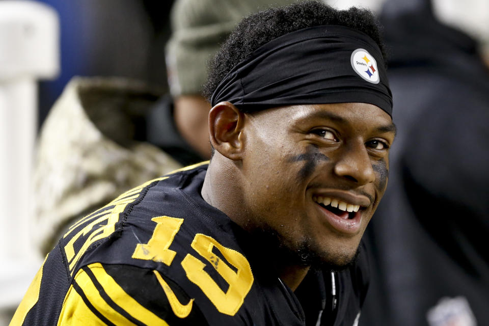FILE - In this Nov. 16, 2017, file photo, Pittsburgh Steelers wide receiver JuJu Smith-Schuster (19) smiles on he sideline during an NFL football game against the Tennessee Titans, in Pittsburgh. Pittsburgh Steelers rookie wide receiver JuJu Smith-Schuster and Cincinnati Bengals cornerback George Iloka have been suspended one game each by the NFL for violating league safety rules. Smith-Schuster was flagged for unnecessary roughness and taunting after a blindside hit on Bengals linebacker Vontaze Burfict in the fourth quarter of Pittsburgh's 23-20 victory Monday night, Dec. 5. Iloka was penalized for unnecessary roughness for a helmet-to-helmet hit on Steelers wide receiver Antonio Brown. (AP Photo/Keith Srakocic, File)