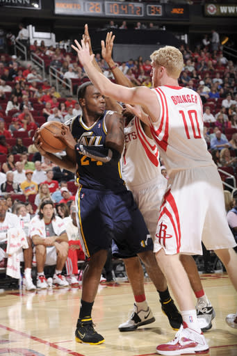 HOUSTON, TX - APRIL 11: Paul Millsap #24 of the Utah Jazz drives the ball against Kyle Lowry #7 and Chase Budinger #10 of the Houston Rockets on April 11, 2012 at the Toyota Center in Houston, Texas. (Photo by Bill Baptist/NBAE via Getty Images)