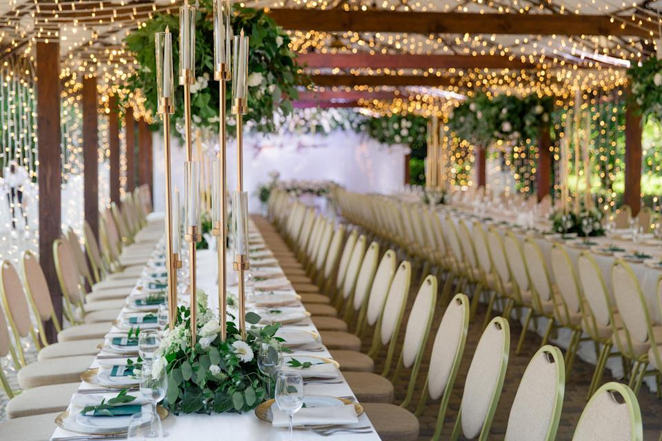 Rows of seating accented with flowers on the tables and tea lights overhead