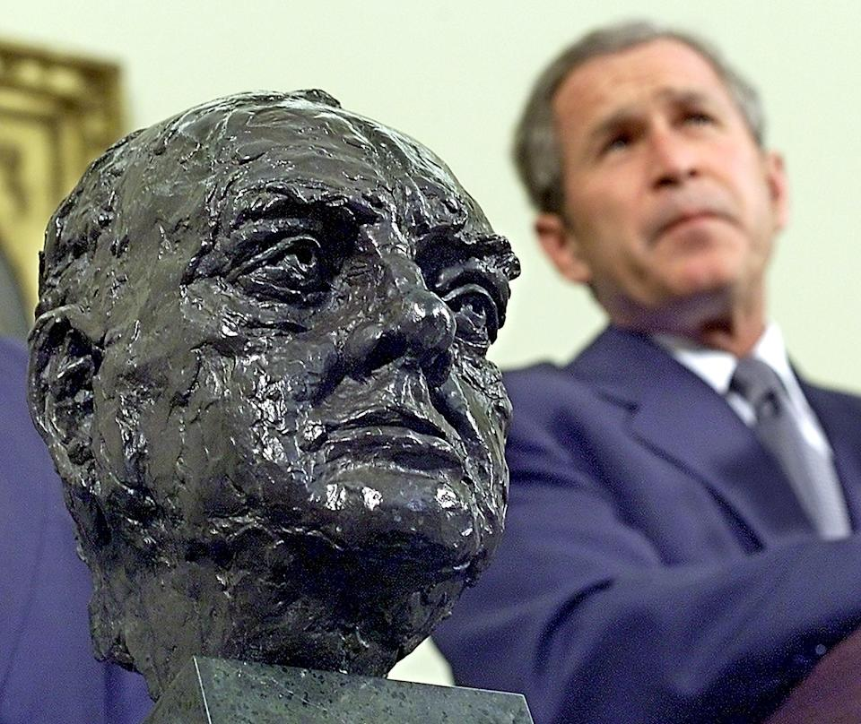 George W Bush received the bust of Sir Winston Churchill from the British Ambassador in 2001 (AFP via Getty Images)