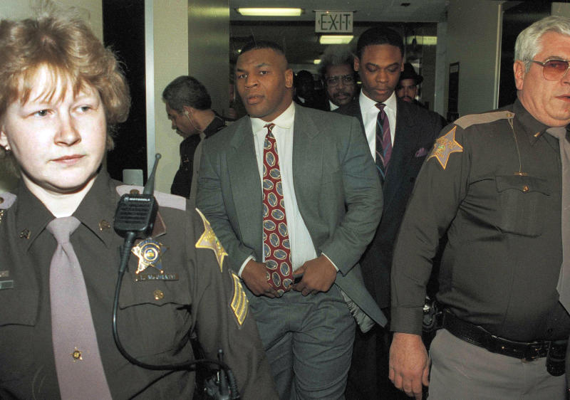 "FILE - In this Feb. 11, 1992, file photo, boxer Mike Tyson hitches his pants as he leaves the court in Indianapolis after being convicted on one count of rape and two counts of criminal deviate conduct. At one time he was the baddest man on the planet, a heavyweight champion who terrorized anyone who got in his way, inside the ring or out. More recently he's unburdened himself as perhaps the most tortured soul on earth, with a one-man show on Broadway that Spike Lee has turned into an HBO special airing Nov. 16. Now he's got a new autobiography that might be the most soul baring book of its genre ever written. The title is ""Undisputed Truth,"" and the truth is that Mike Tyson is one messed up dude. (AP Photo/Tom Strattman, File)"