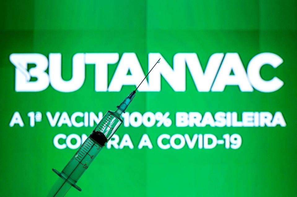 SPAIN - 2021/04/01: In this photo illustration, a medical syringe seen displayed in front of the Butanvac vaccine logo. (Photo Illustration by Thiago Prudencio/SOPA Images/LightRocket via Getty Images)