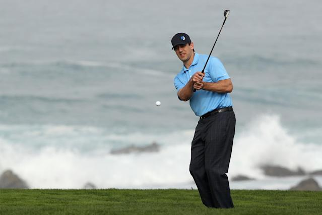 PEBBLE BEACH, CA - FEBRUARY 10: Aaron Rodgers, NFL quarterback on the Greenbay Packers, chips to the 12th green during the second round of the AT&T Pebble Beach National Pro-Am at the Monterey Peninsula Country Club (Shore Course) on February 10, 2012 in Pebble Beach, California. (Photo by Ezra Shaw/Getty Images)