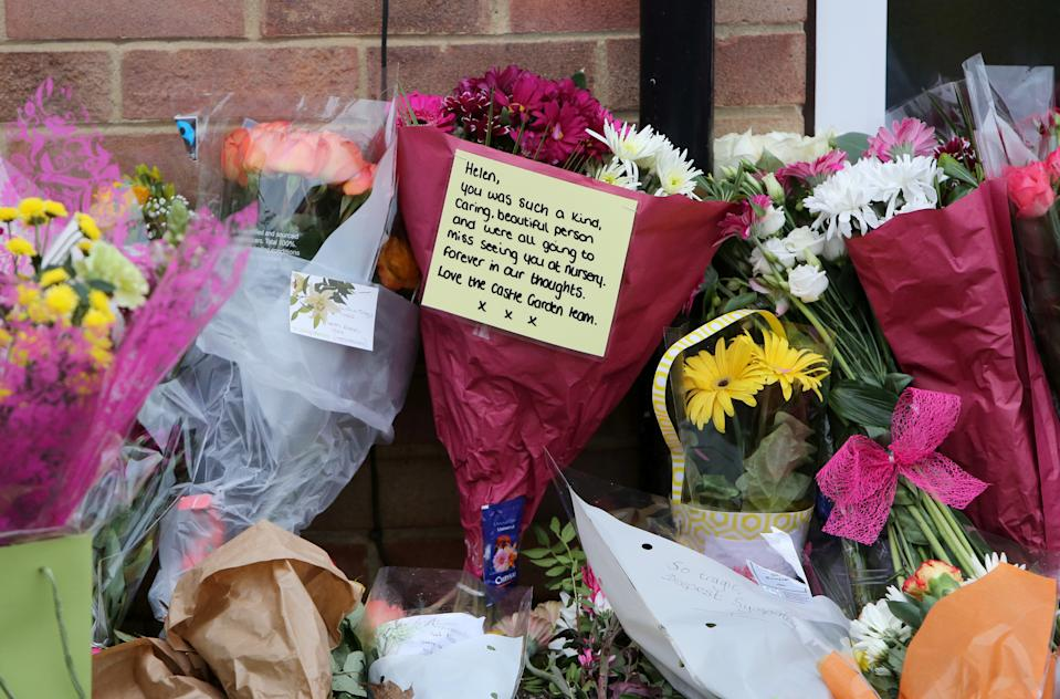 Floral tributes outside the property in Duffield, Derbyshire. (Anita Maric/SWNS)
