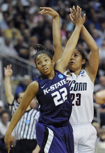 Connecticut's Kaleena Mosqueda-Lewis, right, follows through on a three-point basket while guarded by Kansas State's Mariah White, left, during the second half of an NCAA tournament second-round college basketball game in Bridgeport, Conn., Monday, March 19, 2012. Connecticut won 72-26. (AP Photo/Jessica Hill)