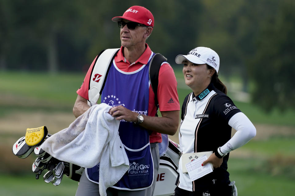 Jin Young Ko, of South Korea, right, smiles after finishing the first round of the Cognizant Founders Cup LPGA golf tournament, Thursday, Oct. 7, 2021, in West Caldwell, N.J. (AP Photo/John Minchillo)