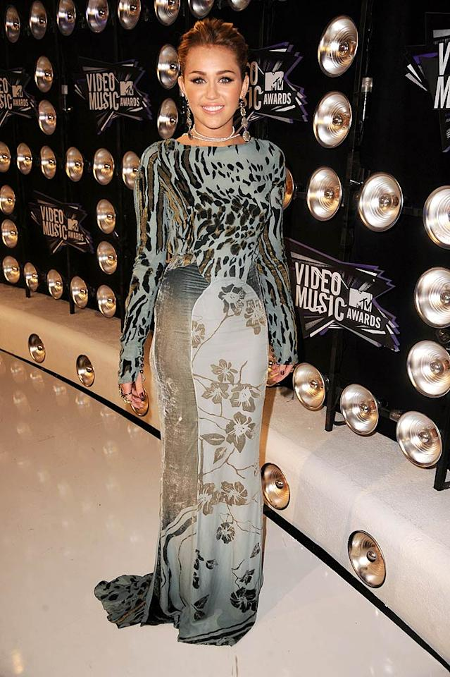 "Yikes! What was up with Miley Cyrus' mess of a dress? Not only was the long-sleeve, mish-mosh printed Roberto Cavalli gown age inappropriate for the 20-year-old, it was just plain bizarre! Jeff Kravitz/<a href=""http://www.filmmagic.com/"" target=""new"">FilmMagic.com</a> - August 28, 2011"