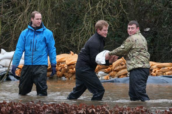 DATCHET, UNITED KINGDOM - FEBRUARY 14:  Prince William, Duke of Cambridge and Prince Harry help with flood defences around Eton End School on February 14, 2014 in Datchet, United Kingdom. Flood water has remained high in some areas and high winds are causing disruption to other parts of the UK with the Met Office issuing a red weather warning.  (Photo by Peter Macdiarmid/Getty Images)