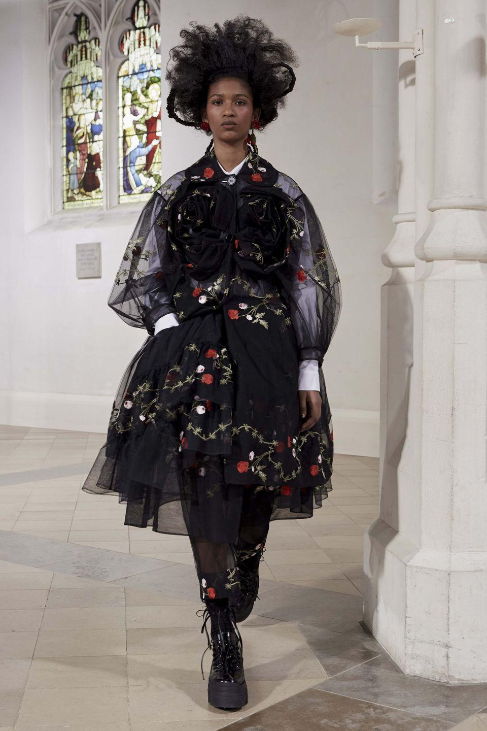"<p>""The winter roses. Clarity and identity, precise, stronger, signature,"" were some of the words Simone Rocha used to describe the inspiration behind her autumn/winter 2021 collection, which was presented via an audience-free catwalk show this afternoon in London. </p><p>The designer's trademark embroidery, tulle and feminine shirting were paired with black leather and lace in a collection that the designer described in her show notes as her take on ""thinking of clothes in a protective and practical way"". Scroll down to see some highlights from the collection – <a href=""https://www.youtube.com/watch?v=5hLehVSTXnQ&feature=youtu.be"" rel=""nofollow noopener"" target=""_blank"" data-ylk=""slk:and watch the beautiful show in full here"" class=""link rapid-noclick-resp"">and watch the beautiful show in full here</a>.</p>"